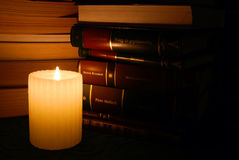 Candle in library Stock Photography