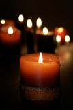 Candle light. Red candle isolated on black background with candle lights Stock Photos