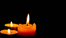 Candle light. Three candles isolated on black Royalty Free Stock Photography