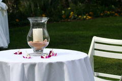 By candle light. A wedding centerpiece with shells and candle Stock Image