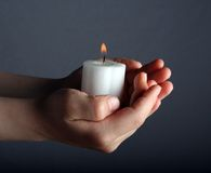 Candle Light. A child's hands holding a candle Stock Photography