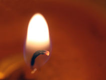 Candle light. Closeup of a burning candle royalty free stock photography