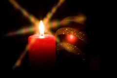 Candle light. Red candle flame a black background Royalty Free Stock Photo
