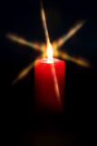 Candle light. Red candle flame a black background Stock Photography