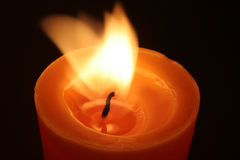 Candle light. In the wind Royalty Free Stock Images