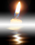Candle light. A Candle on water surface with reflection stock image