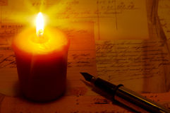 Candle Light. With a Pen and letters Stock Images