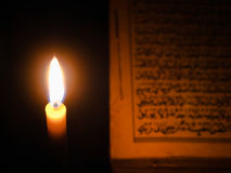 Candle light and Al-Quran Stock Images