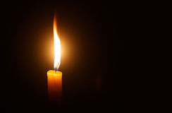 Candle light as light for life. Candle light  for spirituality ceremony against black background Stock Images
