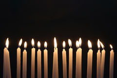 Candle light on black background. Closeup of plastic puzzles with numbers Royalty Free Stock Photos