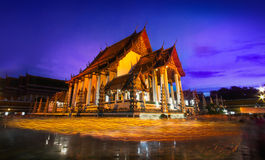 Candle light from buddhists are moving around temple on full moon day, Bangkok,Thailand. Royalty Free Stock Photo