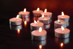 Candle light. Candles burning red light on desk Royalty Free Stock Image