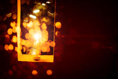 Candle light in Christmas. Blur and soft focus of Candle light with bokeh light in Christmas Stock Photo