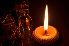 Candle light and Christmas decoration on wood at the dark light. The candle light and Christmas decoration on wood at the dark light Royalty Free Stock Image