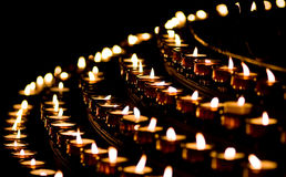 Candle light in a church Stock Photo