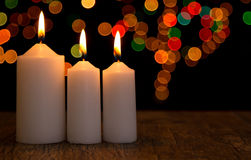 Candle light closeup with bokeh three white Stock Image