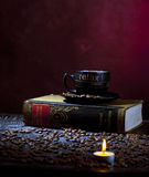 Candle light and coffee. Background decoration with coffee, book and candle Royalty Free Stock Photo