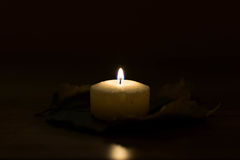 Candle. Light in the dark room by a candle flame Royalty Free Stock Photos
