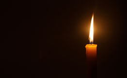 Candle light in darkness  as light for life Stock Photography