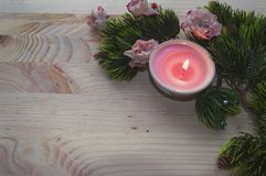 Candle light with christmas decor. Candle light decorated with christmas tree branches and rose flowers Stock Photography