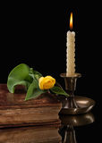 Candle light  with flower on black background Royalty Free Stock Photos