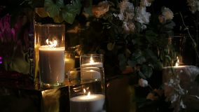 Burning candles in darkness. Close up candles flickering. stock video footage