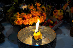 Candle Light. Gold candle light in holy water, Thailand Royalty Free Stock Images