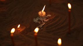 Candle and light on the ground. Candle and light on the ground stock video footage
