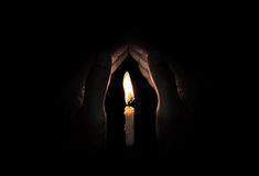 Candle light in hand stock photos