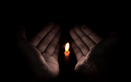 Candle light in hand, Hope concept Royalty Free Stock Photo