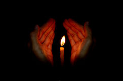 Candle light in hand royalty free stock image