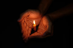 Candle light in hand stock image