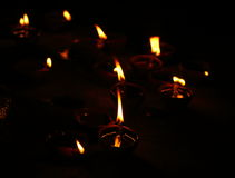 Candle light. Its called Diya and contains oil in it with a piece of cotton which is burning Royalty Free Stock Images