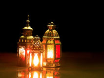 Candle light lids on muslim style`s lantern shining on the dark Stock Photography