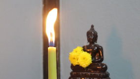 Candle light offerings to Buddha stock footage