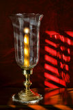 Candle Light in an Old Candleholder with Sunlight Stock Photo