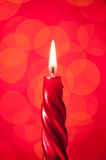 Candle light on pink background Stock Images