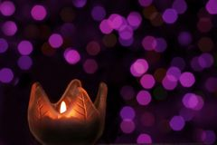 Candle light on purple bokeh Royalty Free Stock Photos