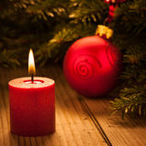 Candle light with red bauble Royalty Free Stock Images