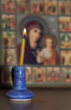 Candle light for religious celebration. Religious symbol. Picture of Saint. Stock Photos