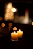 Candle light serenity. A couple of candles on focus at a wedding ceremony stock image
