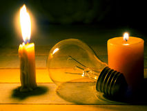 Candle light shine on incandescent bulb Stock Photography
