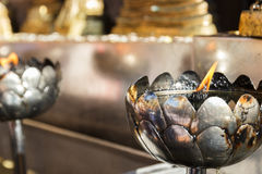 Candle light in silver lotus candlestick Royalty Free Stock Photos