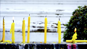 Candle light in the temple daytime Stock Image