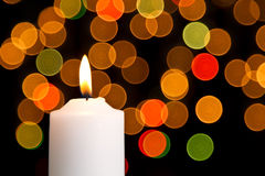Candle light white with bokeh spots Royalty Free Stock Image