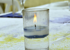 CANDLE LIGHT. Candle wick burning in a glass needed during prayers and giving aesthetics to the table during special ceremonies Stock Images