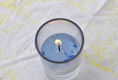 CANDLE LIGHT. Candle wick burning in a glass needed during prayers and giving aesthetics to the table during special ceremonies Royalty Free Stock Photo