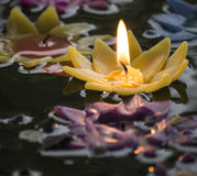 The Candle light on yellow flower on the water Royalty Free Stock Photos