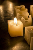 Candle. Lighted candle in a dark background Royalty Free Stock Images
