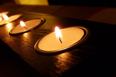 Candle lights. Small candles in a row Royalty Free Stock Photo